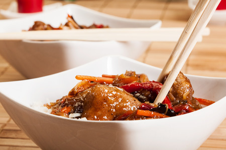 Sweet and sour pork and rice in a bowl photo