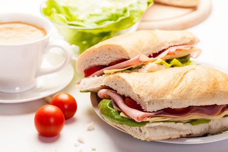 Italian panini sandwich with ham, cheese and tomato photo