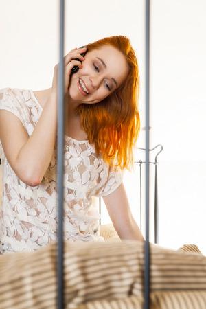 Smiling beautiful woman talking on mobile phone