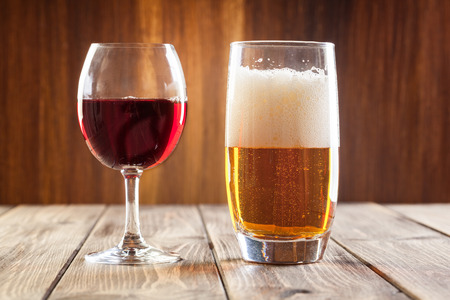 Red wine glass and glass of light beer 스톡 콘텐츠