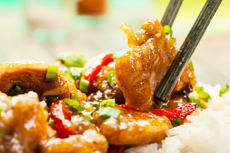 Sirloins on sweet and sour sauce served with boiled rice Stock Photo