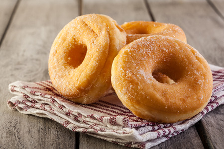 Morning breakfast with donuts and honey Stockfoto