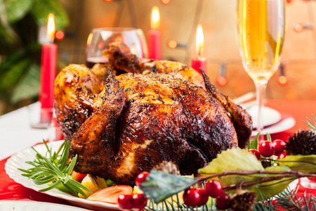 Baked chicken for Christmas dinner on festive table Stock Photo