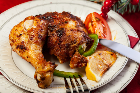 Baked chicken for Christmas dinner on festive table photo