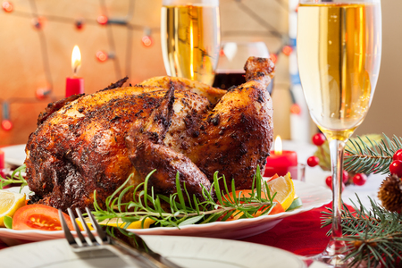 Baked chicken for Christmas dinner on festive table photo