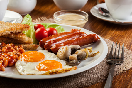 breakfast plate: English breakfast with sausage, eggs and beans