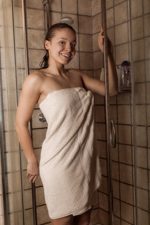 Beautiful young woman after a shower in a towel photo