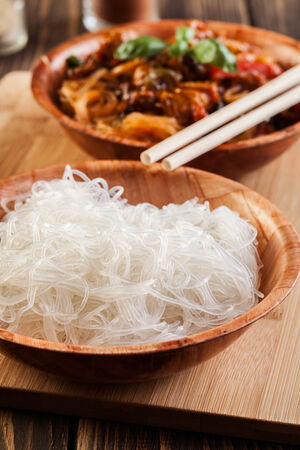 rice noodles: Bowl of rice noodles on wooden table