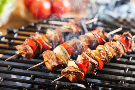 barbecue: Grilling shashlik on barbecue grill. Selective focus