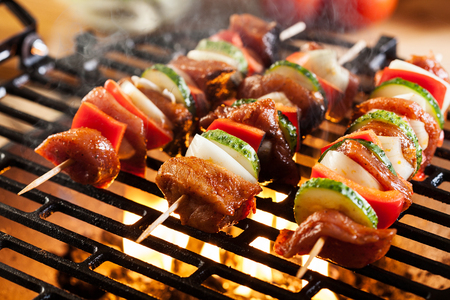 Grilling shashlik on barbecue grill. Selective focus