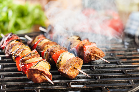 hot grill: Grilling shashlik on barbecue grill. Selective focus