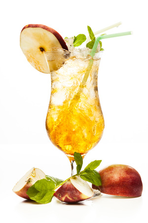 Cider cocktail garnished with a apple on white
