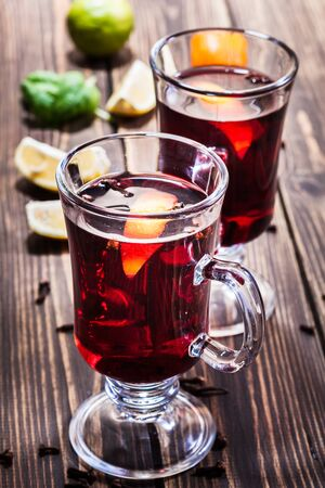 grog: Mulled wine in the glasses, focus on the first glass