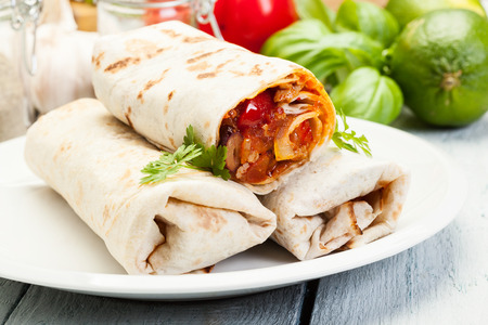 Fresh mexican burritos on a plate Stock Photo