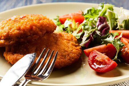 bleu: Cutlet Cordon Bleu with salad on a plate