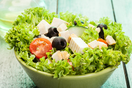 Fresh vegetable salad with cheese and olives