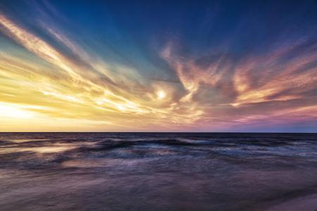 orange sunset: HDR image of Sunset over the Baltic Sea Stock Photo