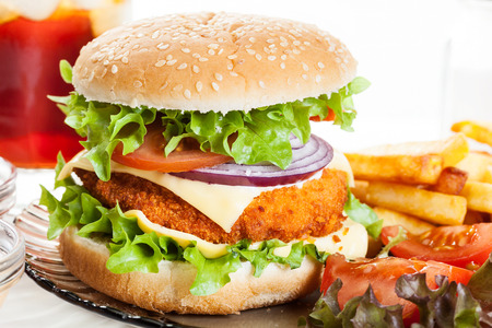 Chicken burger and glass of cola with ice Stockfoto