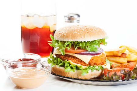 Chicken burger and glass of cola with ice Stock Photo