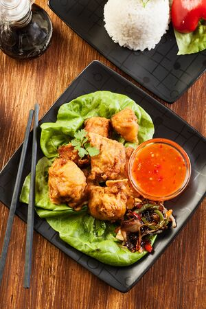 Fried chicken pieces in batter on a plate Stock Photo