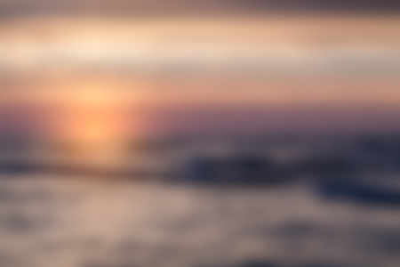 focus on background: Blurry landscape with sunset on sea useful as background