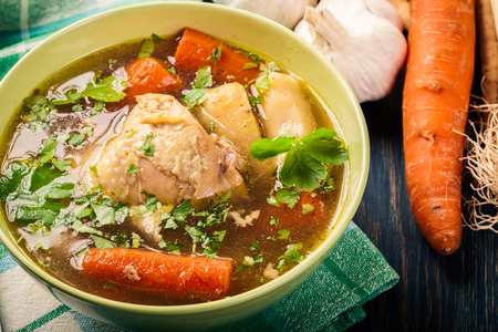 Fresh chicken broth with noodles and carrot