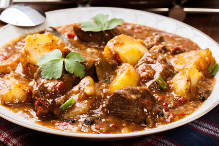 meat dish: Beef stew with potatoes in a plate
