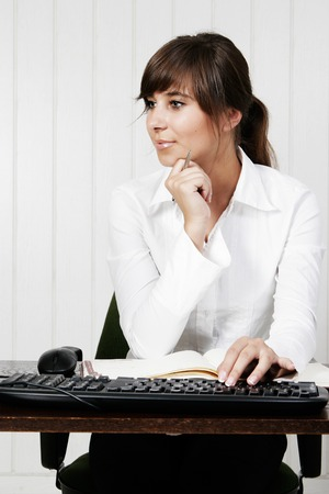 Young woman working with computer