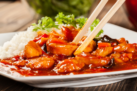 cuisine: Sweet and sour chicken with rice on a plate