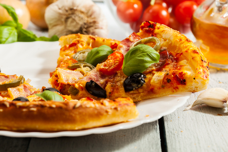 jalapeno pepper: Pizza with bacon, olives and jalapeno pepper on a plate Stock Photo