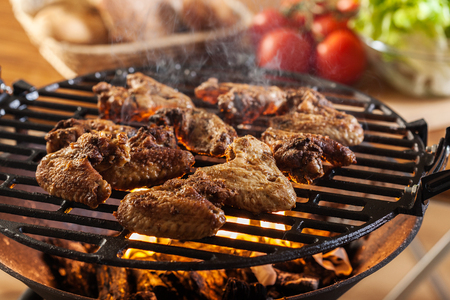 barbecue grill: Grilling chicken wings on barbecue grill. Selective focus