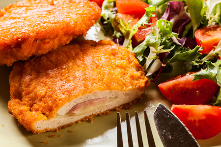 Cutlet Cordon Bleu with salad on a plate Фото со стока - 42664283