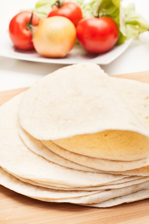cutting: Folded tortillas on cutting board