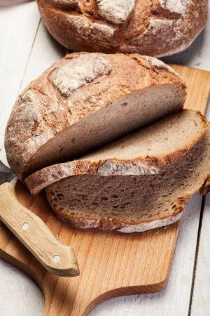 rye bread: Sliced rye bread on a cutting board