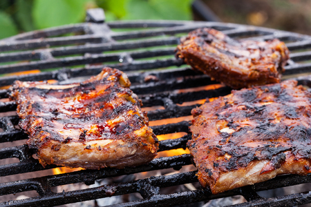 barbecue grill: Grilling pork spareribs on barbecue grill. Selective focus