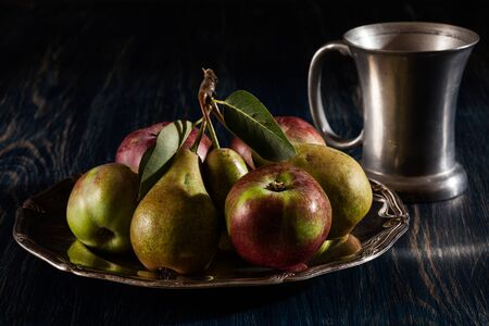 food still: Still life with apples and pears. Dark light Stock Photo