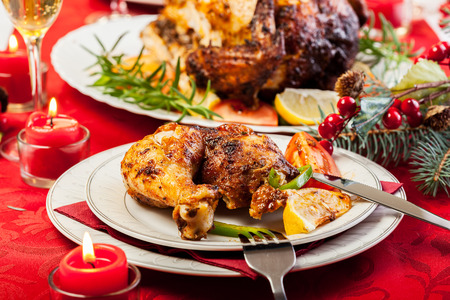 dinner: Baked chicken for Christmas dinner on festive table Stock Photo