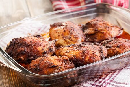 casserole dish: Roasted chicken drumsticks in casserole dish. Selective focus Stock Photo