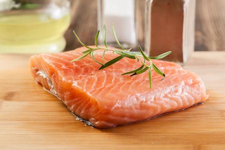salmon filet: Fresh raw salmon filet on wooden cutting board Stock Photo