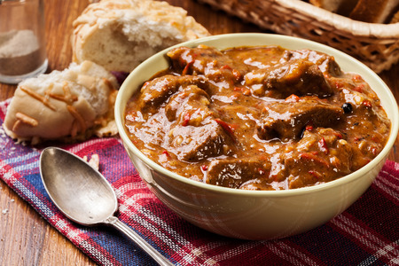 beef stew: Beef stew served with crusty bread in a bowl