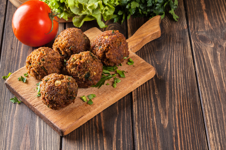 lebanese food: Chickpea falafel balls on a plate with vegetables Stock Photo