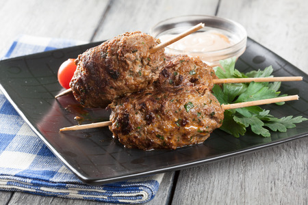 barbecued: Barbecued kofta with vegetables on a plate. Selective focus Stock Photo