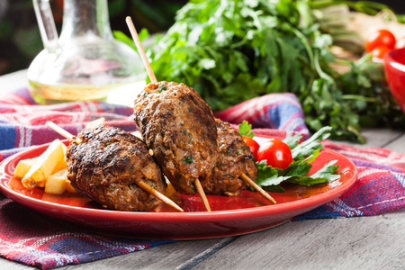 lebanese food: Barbecued kofta with fries on a plate. Selective focus Stock Photo
