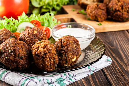 falafel: Chickpea falafel balls on a plate with vegetables Stock Photo