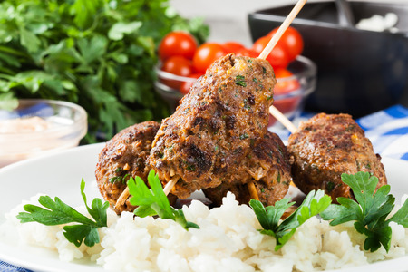 barbecued: Barbecued kofta with rice on a plate. Selective focus