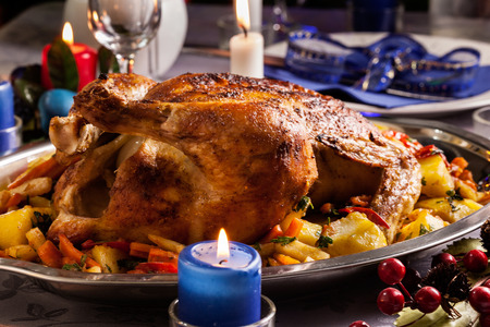 traditional christmas dinner: Baked whole chicken for Christmas dinner on festive table Stock Photo