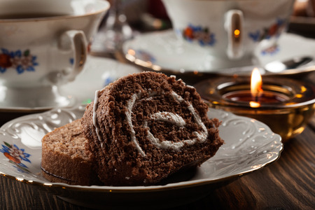 christmas tea: Cake on the high tea set on festive table