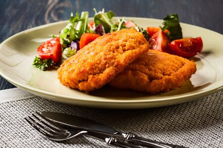 cordon: Cutlet Cordon Bleu with salad on a plate