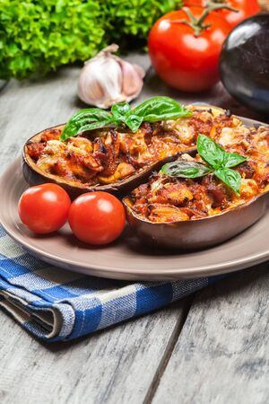 Baked eggplant with pieces of chicken in tomato sauce Stock Photo