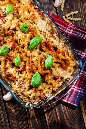fusilli: Casserole fusilli pasta with sausage, zucchini, paprika and cheese